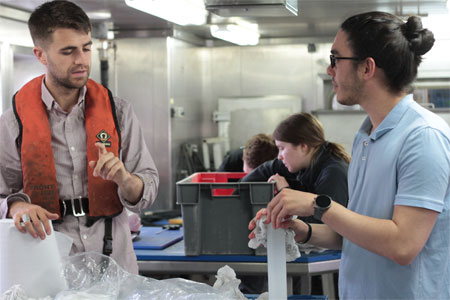 Luke O'Neill and Dr. Aaron Lim at work in the Wet Lab on the RV Celtic Explorer. Photo: Kennedy Browne