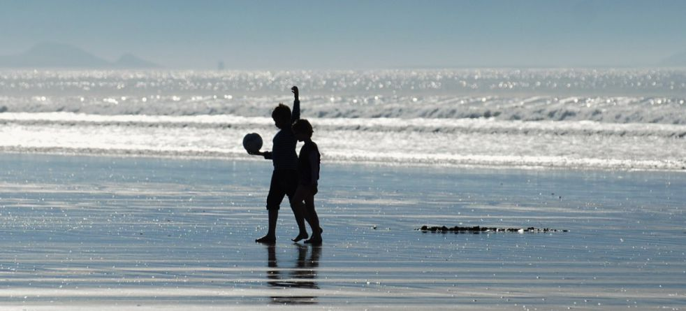 Harnessing Our Ocean Wealth image - kids playing on beach