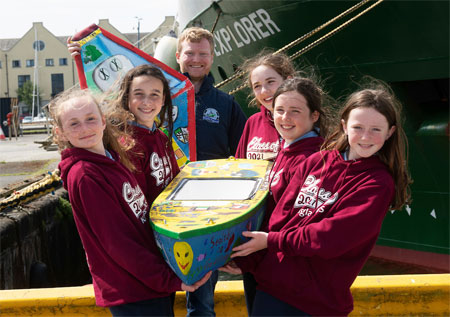 On Monday 31st May, 5th and 6th class students (from the same pod) from Kilglass National School in Co Galway delivered their 1.5 metre unmanned mini sailboat called 'Seoltóir Na Gaillimhe – the Galway Sailor' to the Marine Institute's research vessel, RV Celtic Explorer, in Galway Harbour. They are pictured with Padraic Creedon of the Explorers Education Programme. Photography Andrew Downes.