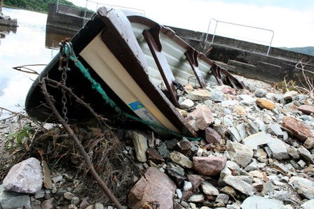 Photo showing damage caused to boats in Feeagh Harbour after extreme rainfall in Newport