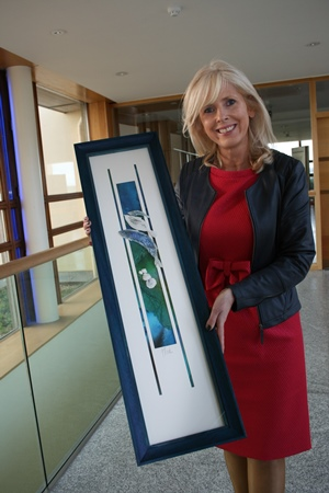 Carmel Dooley with the artwork by Geraldine O'Rourke. Photographer Cushla DromgoolRegan.