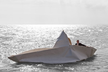 Frank Bôlter is pictured in his giant paper boat that he has made with members of the Kinvara Sailing Club, which he'll be sailing into SeaFest on Saturday 2 July.  The quirky craft will be launched at Kinvara Pier at 12noon and will sail proudly into Galway Harbour alongside a flotilla of Galway Hookers. Photo Credit Alex Battrell