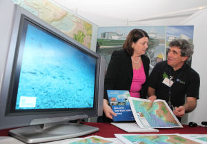 Commissioner Geoghegan-Quinn is presented with a copy of the new marine atlas by Dr. John Joyce of the Marine Institute.(Photo - courtesy NUIG Press Office)