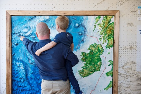 """Hugo Johnston and his father Graham Johnston from the Marine Institute explore Ireland's first """"Sea Science - the Wild Atlantic"""" at Galway City Museum during its official launch by Michael Creed TD Minister for Agriculture, Food and the Marine. """"Sea Science - the Wild Atlantic"""" is a free exhibition and is a partnership between the Marine Institute and Galway City Museum. Photo:Andrew Downes, xposure"""