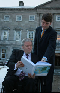Minister Connick and Dr. Peter Heffernan, CEO of the Marine Institute, at the presentation of The Stock Bookoutside Leinster House recently (Photo:Marine Institute)