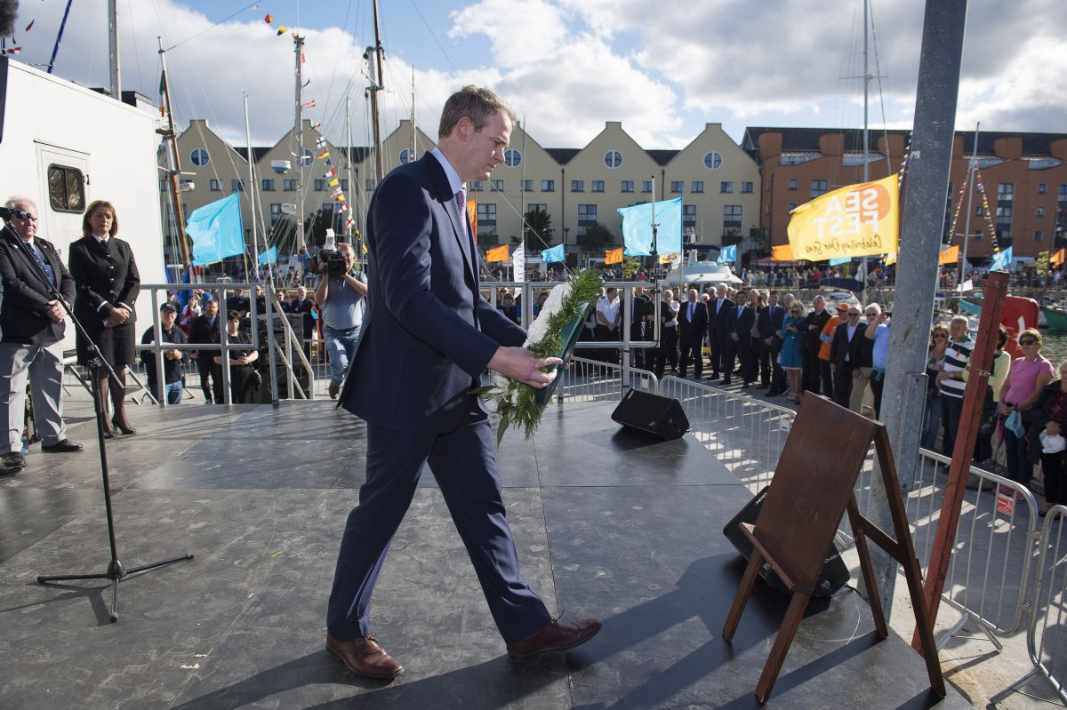 Minister Sean Kyne laying a wreath at the Life and the Sea  - A Commemorative event at SeaFest