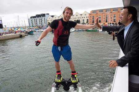 Taoiseach Leo Varadkar getting a high 5 from PowerFly's world champion flyboarders swirling in the air on pump-powered jet packs in the heart of the harbour. Photo Andrew Downes, XPOSURE