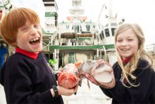 Rang 2 primary school children from Scoil Shéamais Naofa, Bearna got up close to fish and shark species on the RV Celtic Explorer as part of the Marine Institute's Explorers Education Programme. Pictured is Ronan Costello and Lauren Sherlock with an Atlantic Thornyhead and Monkfish. Photo: Andrew Downes, Xposure