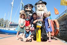 A swell-tering start to SeaFest 2018, Ireland's national maritime festival, in Galway. Pictured with Doug Allan, renowned wildlife and underwater cameraman are Seren Flavin, age 5, and Amy Sarma, age 7, and Alexander Bocquel, age 3. Photo Jason Clarke.